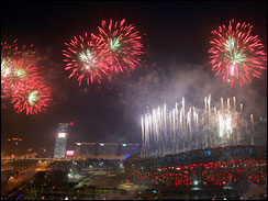 Fireworks explode over the National Stadium, known as the Bird's Nest, during the opening ceremony (AP)