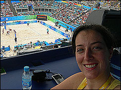 Lauren takes in a beach volleyball match.