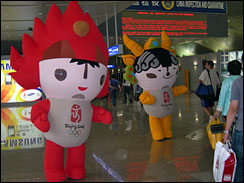 Two of the official 2008 Olympic mascots greet visitors arriving at Beijing Capital International Airport.