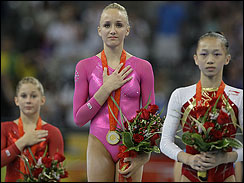 Gold medal-winning gymnast Nastia Liukin of the U.S. listens to the U.S. national anthem after the womens' gymnastics individual all-around finals. (AP)