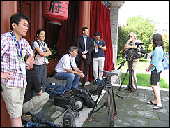 The CBS crew patiently waits for an opportunity to interview Michael Phelps ... which never materialized.