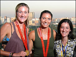 Beach volleyball gold medalists Kerri Walsh, left, and Misty May-Treanor, with Early Show producer Lauren Danza, right.