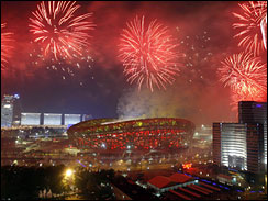 Fireworks explode over the Bird's Nest during the elaborate Closing Ceremony for the Beijing Games.